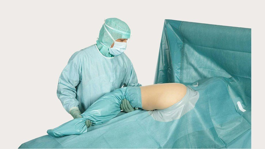 a surgeon using a BARRIER Orthopaedic drape